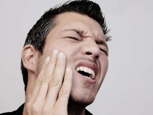 Прекратить зубную боль в домашних условиях
